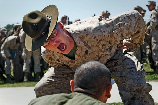 Sgt. Justin Glenn Burnside motivates a recruit with Echo Company, 2nd Recruit Training Battalion at Marine Corps Recruit Depot Parris Island, S.C. (Lance Cpl. David Bessey/Marine Corps)
