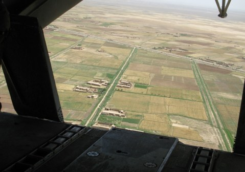 Farm compounds dot Helmand province, Afghanistan, as this photo taken from the back of a CH-53E helicopter today shows. //Dan Lamothe/Staff