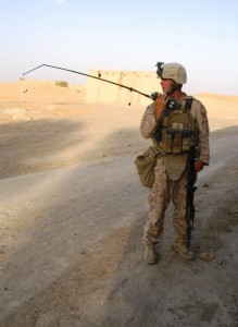 Cpl. Jordan Weaver, a designated marksman and team leader with India Company, 3rd Battalion, 6th Marines, communicates by radio with leadership at Combat Outpost Yazzie during a Marine patrol in Marjah, Afghanistan, last month. (Dan Lamothe//Staff)