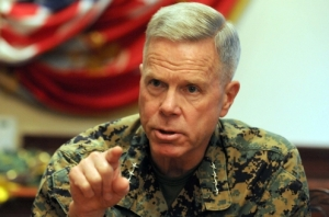 Commandant Gen. Jim Amos makes a point during an interview with Marine Corps Times in 2011. (Thomas Brown / Staff)