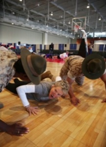 Drill instructors yell at Beth Bass, chief executive officer of the Women's Basketball Coaches Association, during their annual conference.