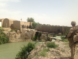 A Marine stands by the Helmand River at FOB Sabit Qadam as Afghan and Marine officials tour the base.