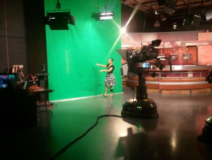 Rhonda A. Lee in front of green screen