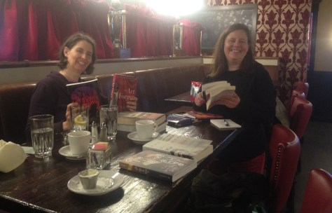 photo of Lory and Charlotte at the table with books