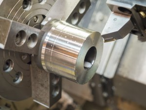 opertor machining mold and die parts for automotive by CNC lathe