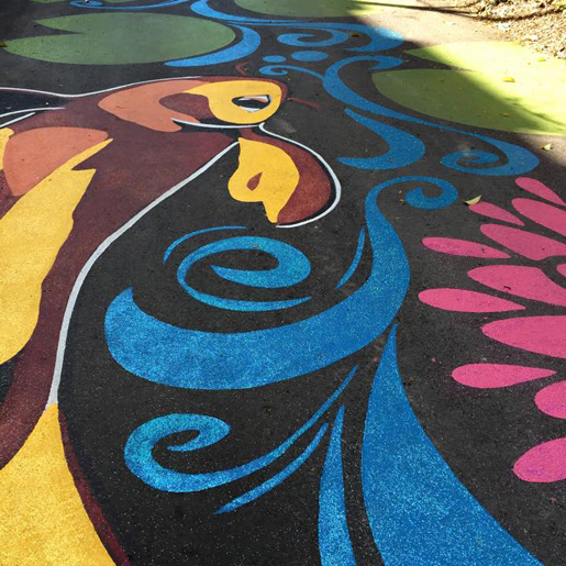 A public alley is painted as a gigantic koi pond by artist Suvi Aika