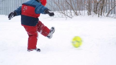 Kick winter in the snow balls
