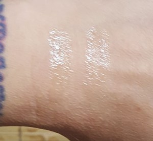 Bobbi Brown Eye Gloss swatches in (l to r) Beach Nude and Island Pink
