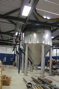 The 1000 barrel fermenters drop into the brewery