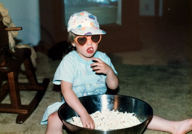 Stephani Bloomquist eating popcorn as a child