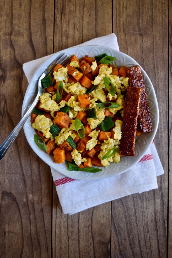 Sweet Potato Hash Recipe | This easy breakfast recipe is a savory spin on sweet potatoes, with lots of spices and garlic, mixed with poblano peppers and scrambled eggs. Serve with a side of tempeh bacon! (Grain-Free, Gluten-Free, Vegetarian, Lectin-Free Option)