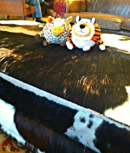 Giraffe and TIger on Cow Ottoman