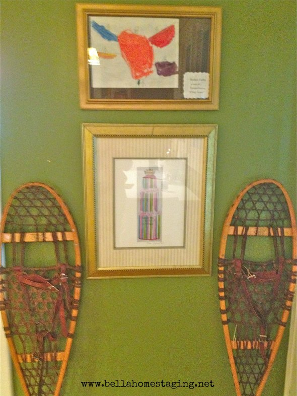framed pictures green wall snow shoes