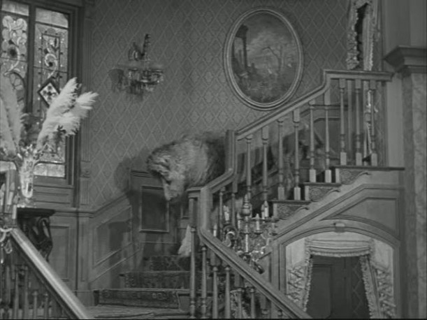 The Addams Family Stairs courtesy of Hooked on Houses