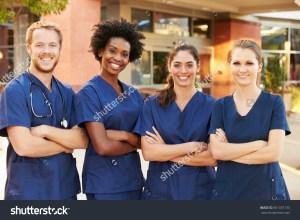 stock-photo-portrait-of-medical-team-standing-outside-hospital-361337135