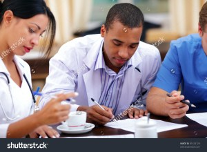 stock-photo-young-african-american-doctor-making-notes-at-the-medical-meeting-81424129