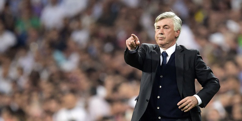 Real Madrid's Italian coach Carlo Ancelotti gestures during the UEFA Champions League semi-final second leg football match Real Madrid FC vs Juventus at the Santiago Bernabeu stadium in Madrid on May 13, 2015. AFP PHOTO/ GERARD JULIEN