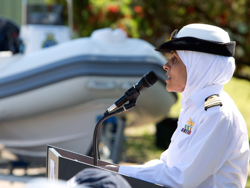 Captain Mona Shindy, RAN, addresses the parade of New Training Ship Australia cadets during the acceptance of a new safety boat pictured in the background.
