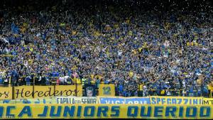 Supporters of Boca Juniors cheer their team before the Argentina First Divison football match against River Plate at La Bombonera stadium in Buenos Aires, Argentina, on April 24, 2016.  / AFP / ALEJANDRO PAGNI        (Photo credit should read ALEJANDRO PAGNI/AFP/Getty Images)