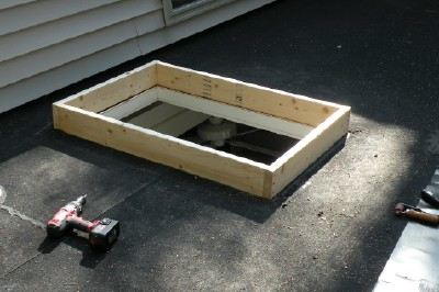 Curb is made of 2x6 framing lumber.