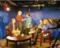 Kim Allyn mics up Heidi Ushakoff before taping Rotary roundtable