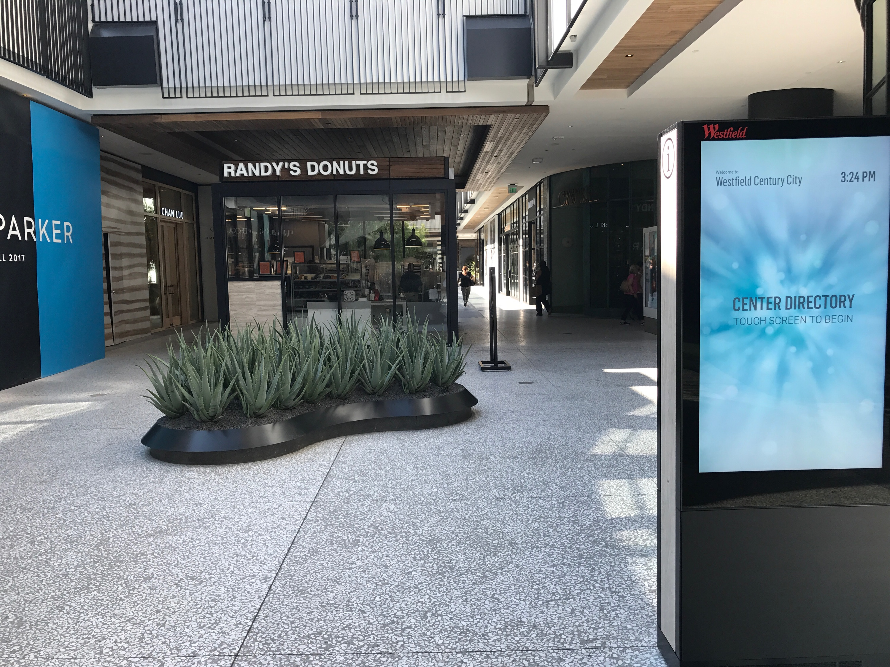 Randy's Donuts sits on the first floor of the mall, near one of the many new touch screen mall directories.