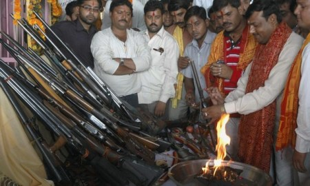 Activists of Bajrang Dal offering prayers to their weapon on the occasion of Dussehra (Courtesy: Reuters)