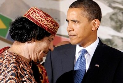 US President Barack Obama, right, and Libyan leader Moammar Gadhafi pictured during the G8/G5 summit in L'Aquila, Italy. (file photo)