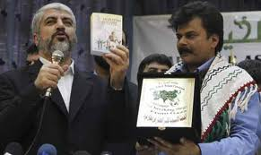 Feroze Mithiborwala (R) Presenting a Gift to Hamas Leader Khaled Meshaal During a Meeting With His Group in Damascus December 22, 2010.
