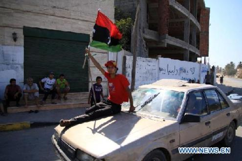Libyan Rebels Search for Gaddafi in Tripoli as NATO Continues Airstrikes