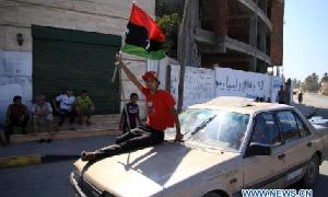 Libyan rebels enter the suburb of Tripoli, capital of Libya (Courtesy: Xinhua/Hamza Turkia)
