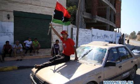 Libyan rebels enter the suburb of Tripoli, capital of Libya (Courtesy: Xinhua/Hamza Turkia)