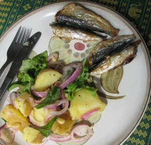 Grilled sardines with warm potato and preserved lemon salad