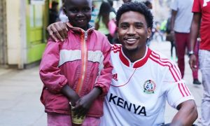 Photo by Mel D. Cole | Trey Songz with a street child