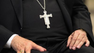 Catholic Priest Sitting Crucifix
