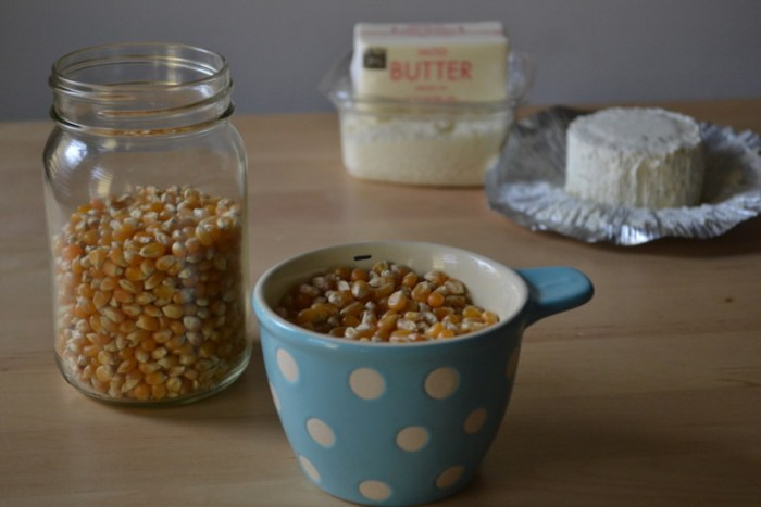 4 ingredients for cheesy parmesan popcorn. Full recipe on BigTasteTinySpace.com