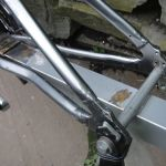 The extension connects to the bike frame at the bottom bracket and dropouts.