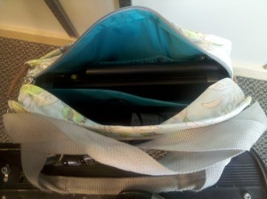 "Po Campo Loop Pannier in ""Free Bird"" fabric with a laptop inside."