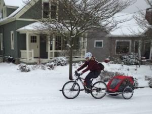 Madeleine Carson, Seattle, WA, pulling her bike trailer on a rare snowy day.