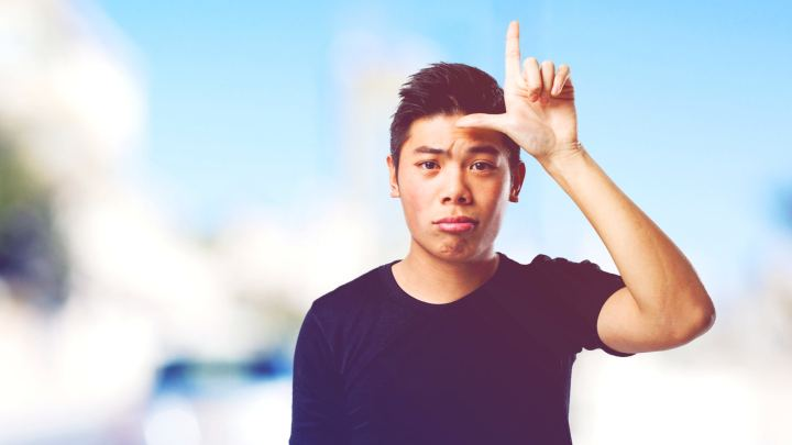 chinese man doing a looser gesture