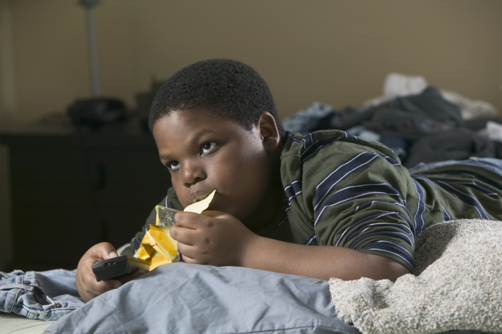 African American boy eating chips
