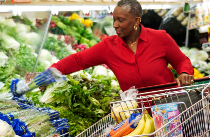 Older African American Black woman grocery shopping