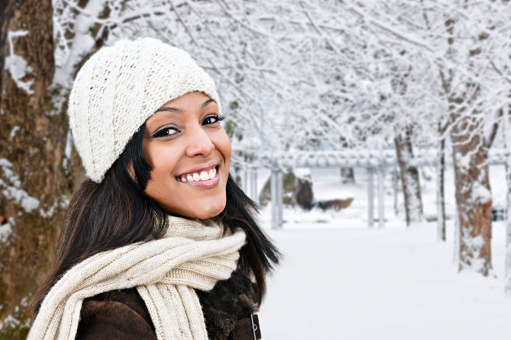 smiling african american woman standing outside in the winter