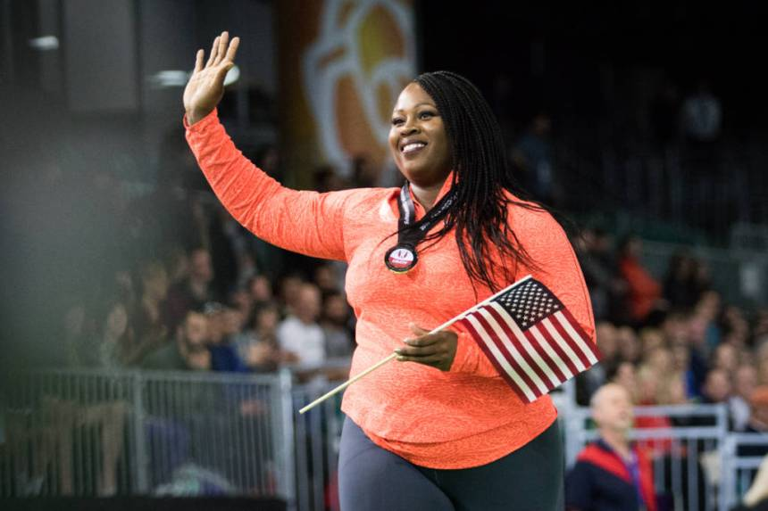 Michelle Carter of Nike takes a victory lap after winning Women's Shot put. The US Indoor Track & Field Championships are held at the Oregon Convention Center in Portland, Ore. on March 11, 2016. (Samuel Marshall/Emerald)