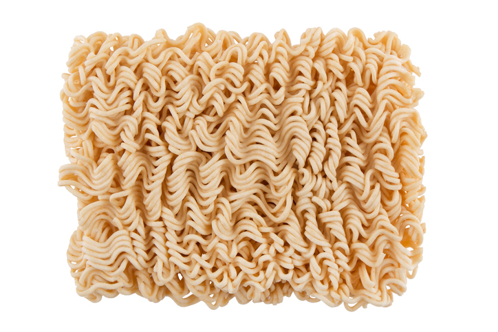 Ramen Noodles in a white Bowl. Isolated on white