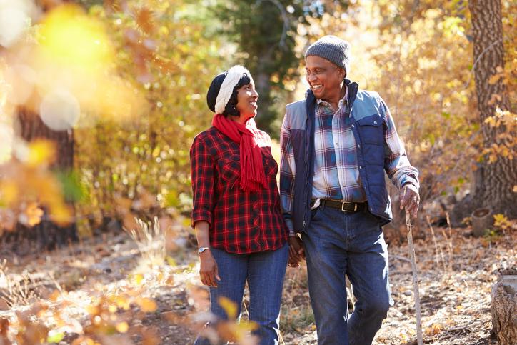 African American couple walking autumn