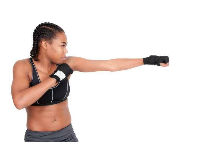 African American woman with braids boxing
