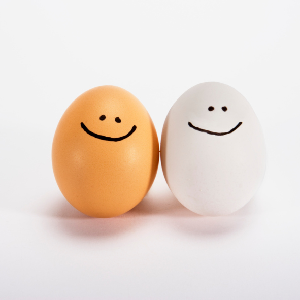 two eggs with smiley faces drawn on them