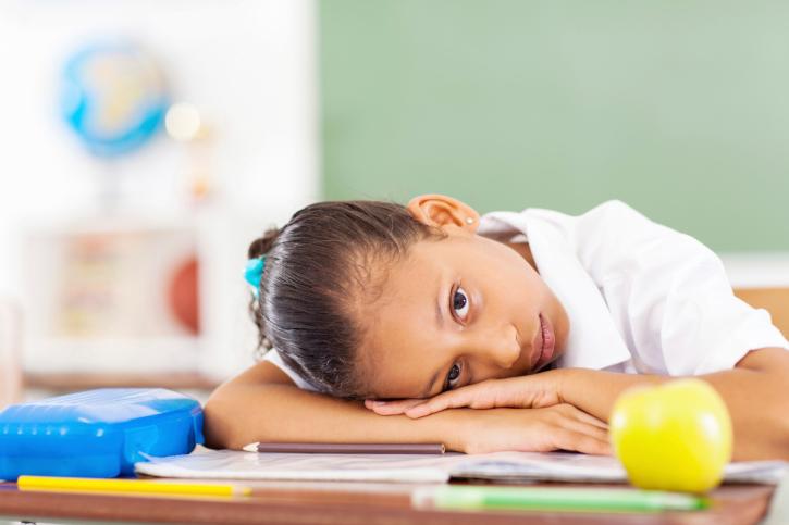 primary schoolgirl resting