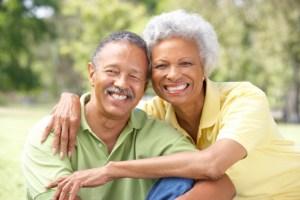 senior couple outdoors smiling